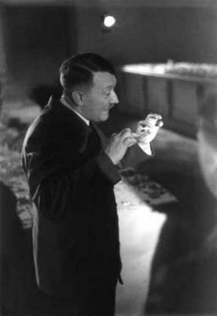 Adolf Hitler explains Speer's model of Linz with the Hitler Museum