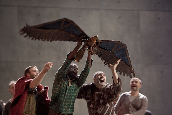 Jon Morris, Erwin E.A. Thomas (with eagle), Peter Straka as The Tall Prisoner, and Vladimir Chmelo as The Short Prisoner. Photo Ken Howard/Metropolitan Opera