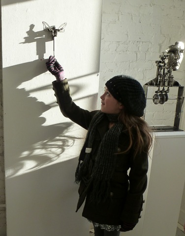 "A young ""viewer"" puts Alexandra Limpert's ""Dragonfly"" (2007) through its paces. Photo © 2012 Louise Levathes."