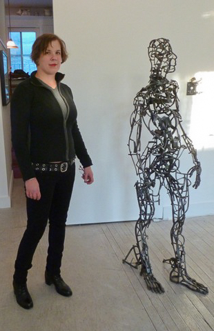 "Brooklyn sculptor Alexandra Limpert beside ""3rd Generation"" (2008). Photo © 2012 Louise Levathes."