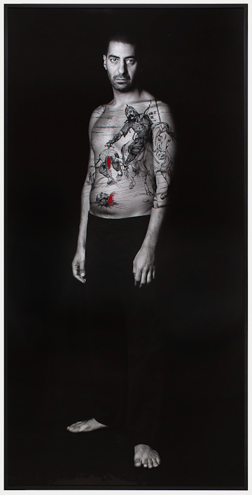 Shirin Neshat Sharif, 2012, Ink on LE silver gelatin print,  99 x 49 1/2 inches (251.5 x 125.7 cm). © Shirin Neshat. Courtesy Gladstone Gallery, New York and Brussels.