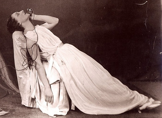 Berthe Bovy in La Voix Humaine by Jean Cocteau. Note the classical Greek peplos style of her nightgown.