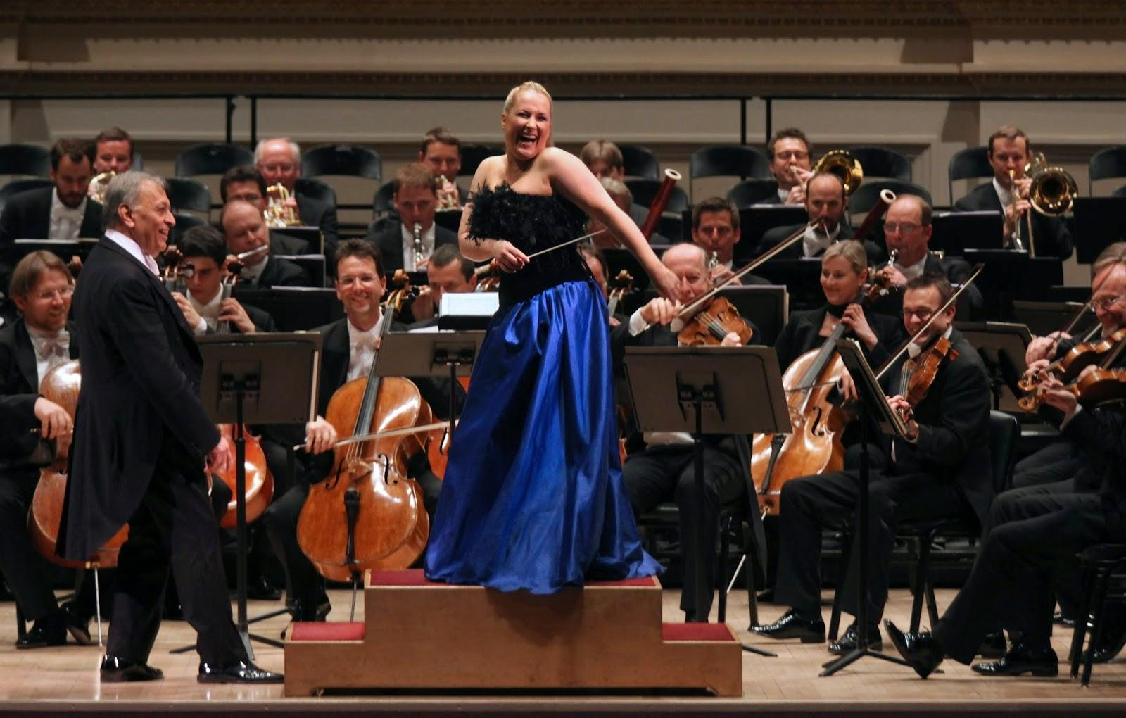 "Diana Damrau closes the final concert of ""Vienna, City of Dreams,"" while maestro Mehta looks on."