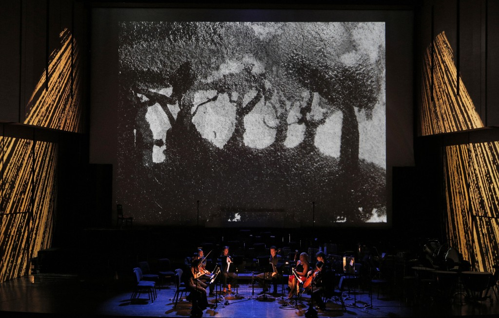 Carlos Chávez, Suite for Double Quartet (Dark Meadow), performed by Amphion String Quartet, Lance Suzuki, flute; Alexandra Knoll, oboe; Benjamin Fingland, clarinet; Monica Ellis, bassoon. Projection design by Doug Fitch and Yoav Gal.