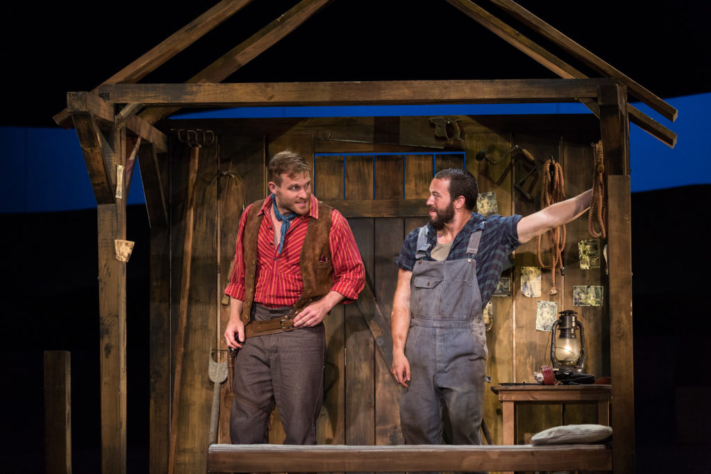 "Jarrett Ott as Curly and Michael Hewitt as Jud Fry in The Glimmerglass Festival's 2017 production of Rodgers and Hammerstein's ""Oklahoma!"" Photo Karli Cadel/The Glimmerglass Festival."