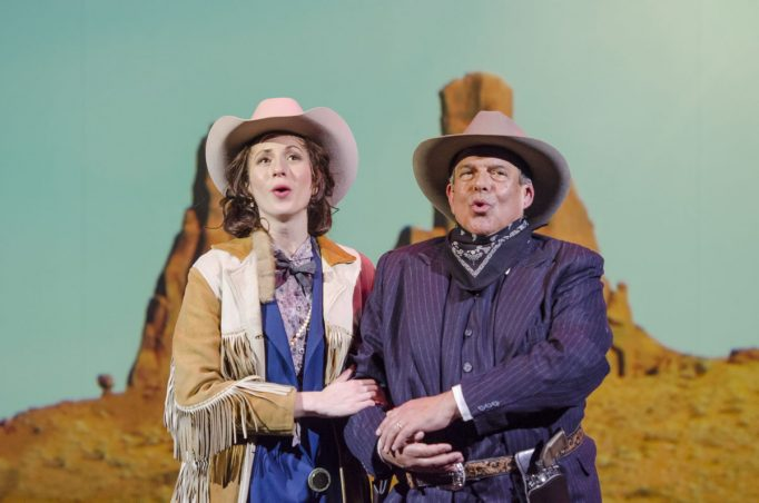n the style of a cowboy western film, Arnold Schoenberg (Omar Ebrahim, r.) and his second wife Gertrud Kolisch (Sarah Womble, l.) trek across the country to their ultimate destination of Los Angeles in Boston Lyric Opera's World Premiere Schoenberg in Hollywood by composer Tod Machover and librettist Simon Robson.