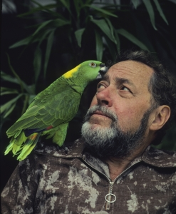 Famous American author and playwright Tennessee Williams (1911-1983) with his pet parrot bird at his home in Key West, Florida. Mr. Williams lived primarily in Key West in his later years.
