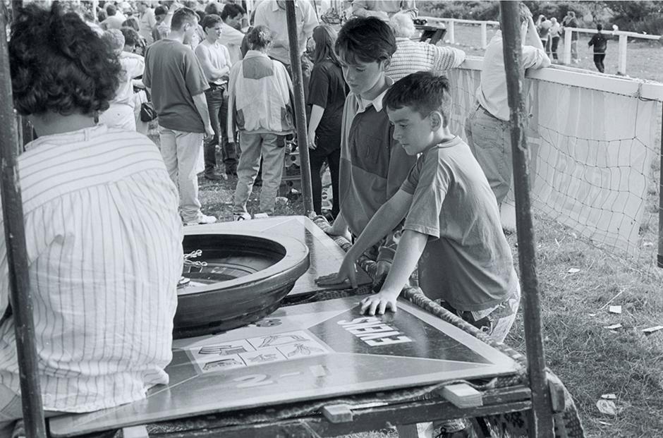 1. Boys at Roulette, Dingle Fair, 1993. Silver Gelatin Print.