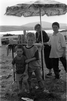 3. Family at Dingle Fair, 1993. Silver Gelatin Print.