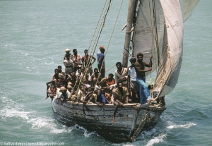 Haitian refugees in small wood boats sailing into Biscayne Bay, Miami