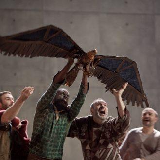 Jon Morris, Erwin E.A. Thomas (with eagle), Peter Straka as The Tall Prisoner, and Vladimir Chmelo as The Short Prisoner. Photo Ken Howard/Metropolitan Opera