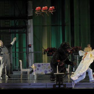 The Bear chases Mime (Wolfgang Ablinger-Sperrhacke) as Siegfried (Torsten Kerl) laughs.