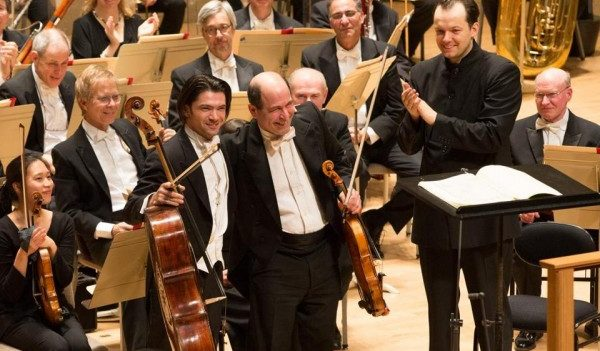 Cellist Gautier Capucon, BSO principal violist Steven Ansell, and Andris Nelsons take their bows following their performance of Strauss's Don Quixote. Photo Michael Blanchard.