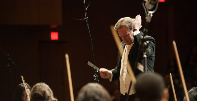 Justin Bischoff conducting athletic the Seventh Annual Outreach Benefit Concert for Children