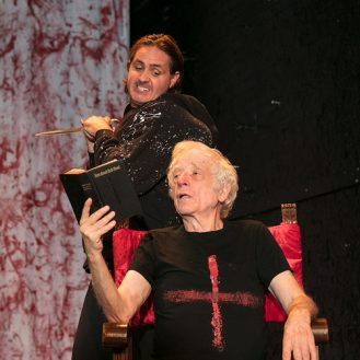 "Matt de Rogatis (standing) and Austin Pendleton (seated) in a scene from ""Wars of the Roses: Henry VI & Richard III"" now playing at the 124 Bank Street Theater through August 19th. Photo Chris Loupos."