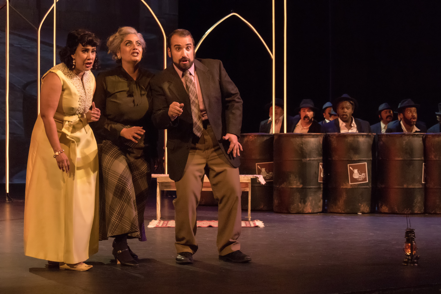 Delia (Monica Yunus), Morgiana (Lauren Semerdijan), and Nadir (Christopher Bozeka), with the forty thieves behind the Moka. Photo Lance W. Ozier.