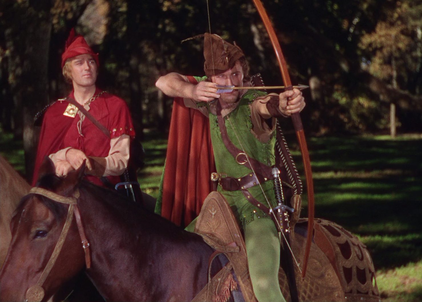 Patrick Knowles (Will Scarlett) and Errol Flynn (Robin Hood) in The Adventures of Robin Hood.