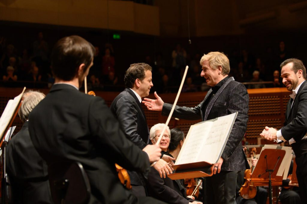 Pianist Jean-Yves Thibaudet, conductor Fabien Gabel, and composer Aaron Zigman take their bows after the U.S. Premiere performance of Zigman's Tango Manos Piano Concerto with the San Francisco Symphony on February 14, 2020 at Davies Symphony Hall. Photo Kristen Loken.