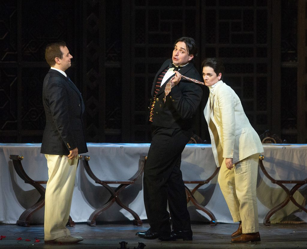 "Etienne Dupuis as the Count, Adam Plachetka as Figaro, and Marianne Crebassa as Cherubino in Mozart's ""Le Nozze di Nozze."" Photo Marty Sohl / Met Opera."