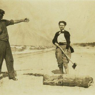 Ruth Crawford Seeger chopping wood with Carl Sandburg.